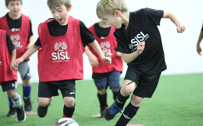 Skills Institute Soccer League players in game